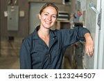 woman technician servicing at... | Shutterstock . vector #1123244507
