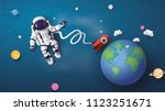 astronaut astronaut floating in ... | Shutterstock .eps vector #1123251671