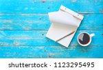 notebook  ballpoint pen and a... | Shutterstock . vector #1123295495
