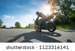motorbike on the road riding.... | Shutterstock . vector #1123316141