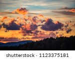 colorful sunset clouds above... | Shutterstock . vector #1123375181