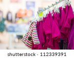 Fleece jackets on stands in kids mall - stock photo
