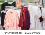 Jackets, blouses and sweaters in kids mall - stock photo