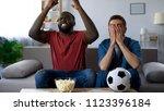 multiracial friends sitting on... | Shutterstock . vector #1123396184