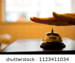 hand ringing in service bell on ... | Shutterstock . vector #1123411034