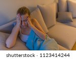 sick woman with a headache... | Shutterstock . vector #1123414244