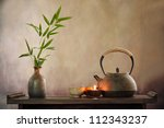 teapot and cup with burning... | Shutterstock . vector #112343237