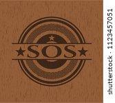 sos badge with wooden background | Shutterstock .eps vector #1123457051