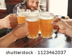 friends clinking glasses with... | Shutterstock . vector #1123462037