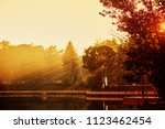 sunset in the park. the lake in ... | Shutterstock . vector #1123462454