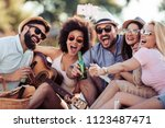 cheerful group of friends with... | Shutterstock . vector #1123487471