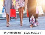 happy girl friends shopping in... | Shutterstock . vector #1123506197