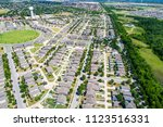 drone view high above suburbia... | Shutterstock . vector #1123516331