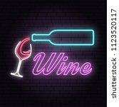 retro neon wine sign on brick... | Shutterstock .eps vector #1123520117