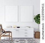 mock up poster in living room ... | Shutterstock . vector #1123550411