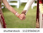 bridal and groom holding hands | Shutterstock . vector #1123560614