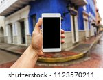 cell phone in a corner | Shutterstock . vector #1123570211