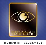gold emblem with eye icon and... | Shutterstock .eps vector #1123574621