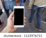 hand holding smartphone with... | Shutterstock . vector #1123576721