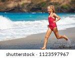 happy barefoot child have fun... | Shutterstock . vector #1123597967