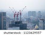 construction cranes on top of... | Shutterstock . vector #1123629557