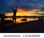 beautiful sunset from the river ... | Shutterstock . vector #1123634681