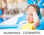 little boy on the beach with a... | Shutterstock . vector #1123666541