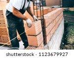 industrial worker  bricklayer ... | Shutterstock . vector #1123679927
