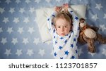 three years old child crying in ... | Shutterstock . vector #1123701857