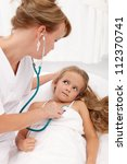 Sick girl examined by female doctor or healthcare professional - stock photo