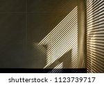 shadow and light through blinds ... | Shutterstock . vector #1123739717