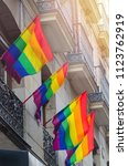 gay flags waving in the streets ... | Shutterstock . vector #1123762919