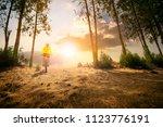 man riding mountain bike on... | Shutterstock . vector #1123776191