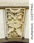 Small photo of Double face, Janus head as capstone on a doorway arch, Koenigstein, Saxony, Germany.