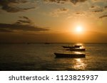 the beautiful beach and sea of... | Shutterstock . vector #1123825937