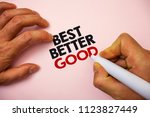 Small photo of Writing note showing Best Better Good. Business photo showcasing improve yourself Choosing best choice Deciding Improvement Marker pen paper Ideas messages remember information important pink.
