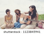 younger asian woman friend... | Shutterstock . vector #1123845941