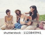 younger asian woman friend... | Shutterstock . vector #1123845941
