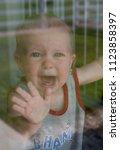 upset caucasian toddler baby... | Shutterstock . vector #1123858397