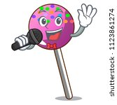singing lollipop with sprinkles ... | Shutterstock .eps vector #1123861274