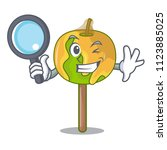 detective candy apple character ... | Shutterstock .eps vector #1123885025