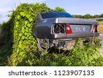 car wreck and evening light | Shutterstock . vector #1123907135