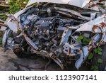 car wreck and evening light | Shutterstock . vector #1123907141