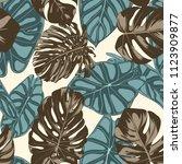 tropical leaves. seamless... | Shutterstock .eps vector #1123909877