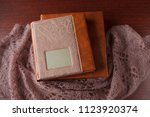 elegant brown book and a box... | Shutterstock . vector #1123920374
