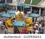 tourist praying at erawan... | Shutterstock . vector #1123926611