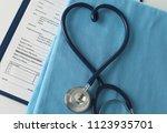 a stethoscope shaping a heart... | Shutterstock . vector #1123935701