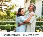 happy senior couple dancing... | Shutterstock . vector #1123955294