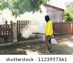 guys are spraying fumes in the... | Shutterstock . vector #1123957361