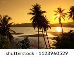 sunset over the tropical beach... | Shutterstock . vector #1123960529